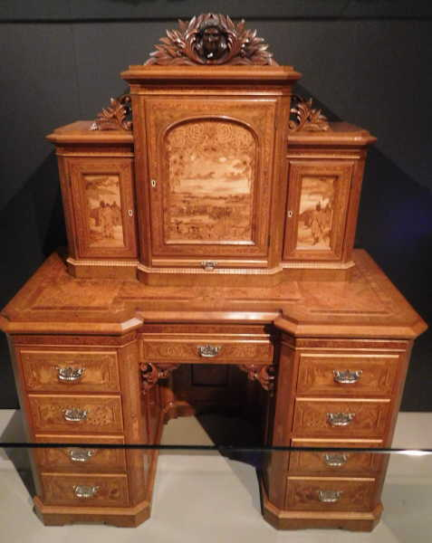 carved wood desk at the museum